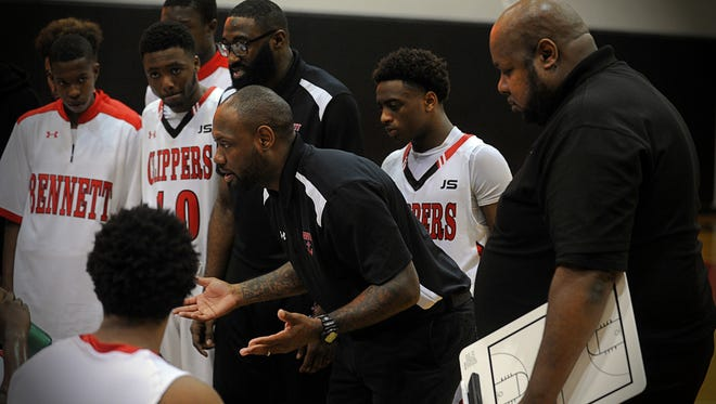 Andre Collins talks with his team during the Governor's Challenge basketball tournament.