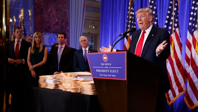 President-elect Donald Trump speaks during a news conference Wednesday in which he acknowledged that he believed Russia likely was behind hacking into the hacking of Democratic Party campaign officials.