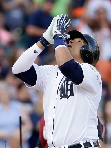 Detroit Tigers' Victor Martinez celebrates his solo