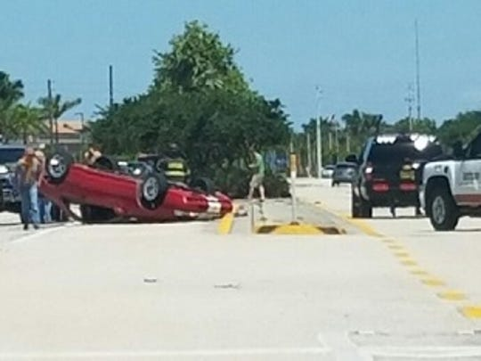 A car crash forced this car onto its roof on U.S. 41 in Estero on Tuesday.