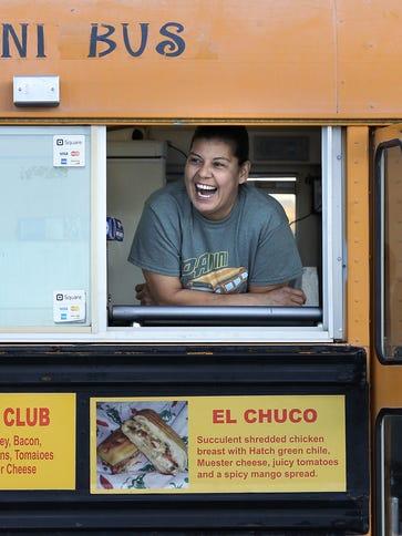 Panini Bus owner Cynthia Bertoldo jokes with customers