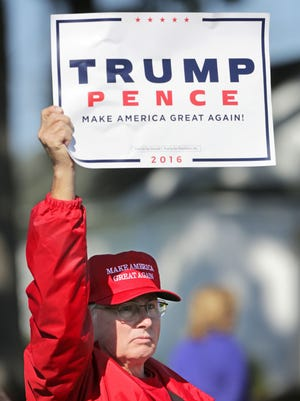 Mike Goril, of Lake Geneva, Wis., holds a sign for Republican Presidential nominee Donald Trump and running mate Indiana Gov. Mike Pence during the entirety of the 1st Congressional District Republican Party of Wisconsin's Fall Fest in Elkhorn on Saturday, Oct. 8, 2016. (Anthony Wahl/The Janesville Gazette via AP)