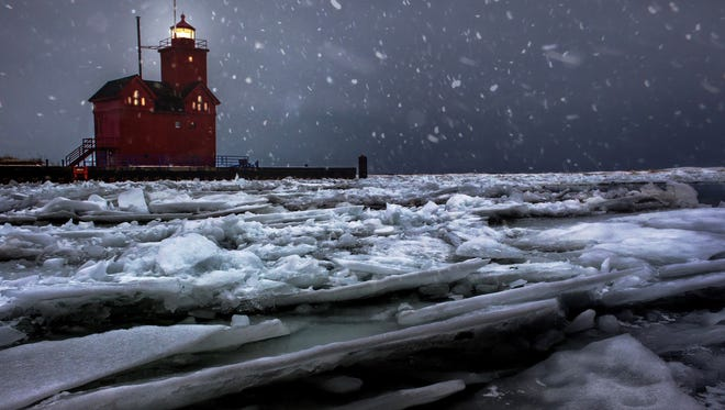 """CITY AND COUNTRY WINNER: A blizzard was hitting Lake Michigan in Holland when Chase Gagnon of Madison Heights lay down on the breakwall and put his camera near the icy water to create """"Big Red Blizzard."""" He said, """"I had no idea if my composition was good or bad until I brought the camera back up to check. I think I had to do this six or seven times until I had a shot I liked.  After that I went back to my car and turned the heat up as high as it would go."""""""