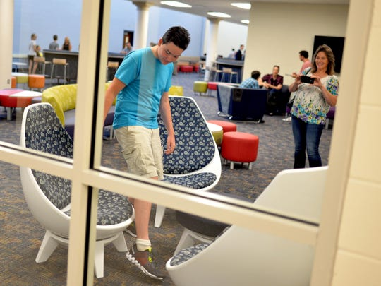 Rising CCTec engineering technology freshman Harrison Bruck, 14, of Upper Deerfield (left), explores the schools new media room while his mother Brenda Bruck takes a picture on her phone following a press event there Wednesday, Aug. 10, 2016 in Vineland.