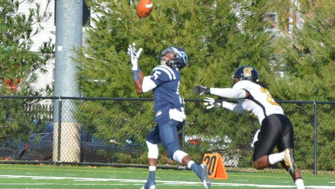 Wesley's Alex Kemp had 143 receiving yards and three touchdown catches as the Wolverines defeated Framingham State on Saturday.