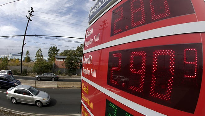 Gas prices below $3 dollars are displayed at a gas station, Wednesday, Oct. 15, 2014, in Jersey City, N.J.