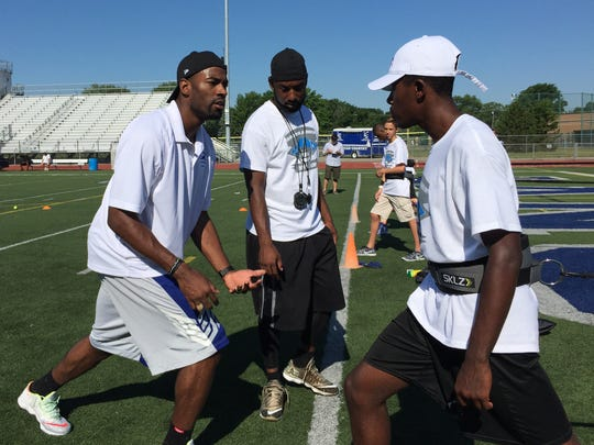 Retired Detroit Lions WR Calvin Johnson at his annual football camp at L'Anse Creuse high school Saturday, June 25, 2016.