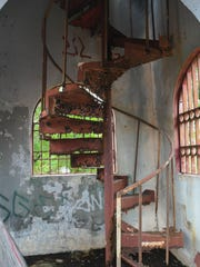 The Umatac Bridge towers' rust-damaged spiral staircase