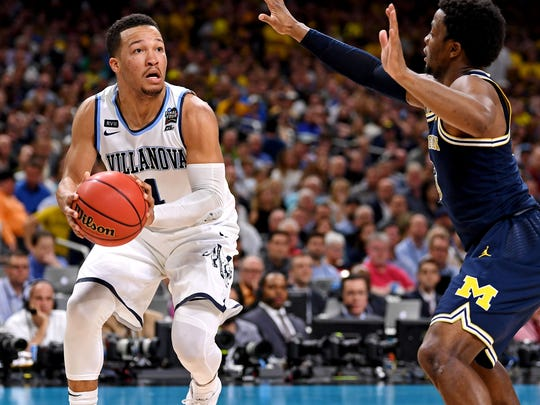 Villanova Wildcats guard Jalen Brunson (1) handles the ball against Michigan Wolverines guard Zavier Simpson (3) during the first half in the championship game of the 2018 men's Final Four at Alamodome.
