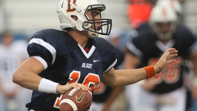 Blackman's quarterback Miller Armstrong scrambles in the backfield looking for a receiver during the first game of the Middle Tennessee Classic against Chalkville at MTSU's Floyd Stadium Saturday, Aug. 22, 2015.