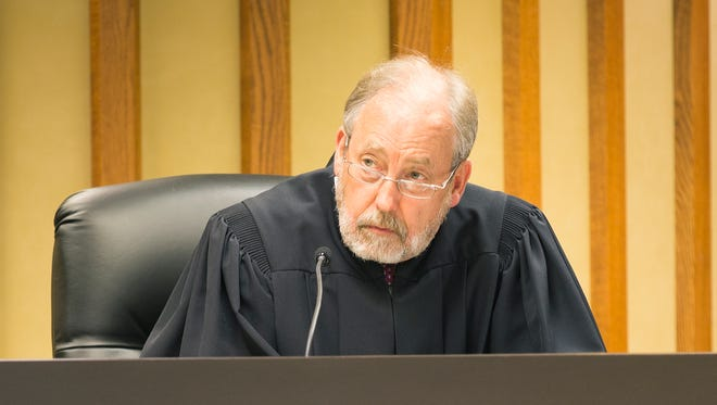 Fond du Lac County Judge Gary Sharpe listens Tuesday to  Dennis Brantner's defense attorney Craig Powell explain why he feels  Sharpe should not recuse himself from the case.