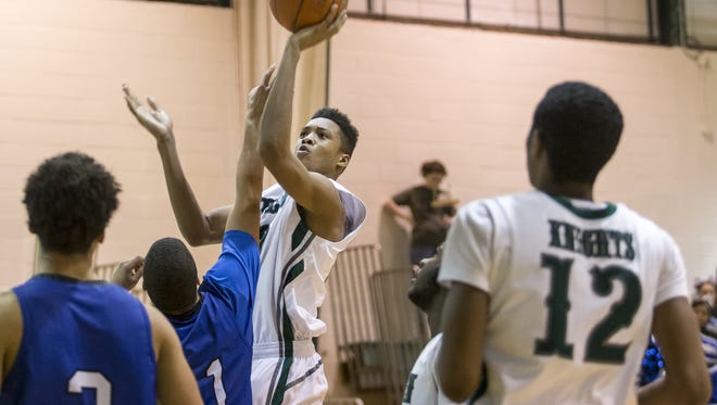 Sophomore forward KVonn Cramer (shooting) and other key returnees make Mount Pleasant No. 1 in The News Journal's first boys basketball rankings of the season.