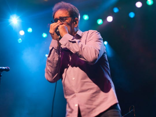 Due to hearing loss from Meniere's disease, Huey Lewis