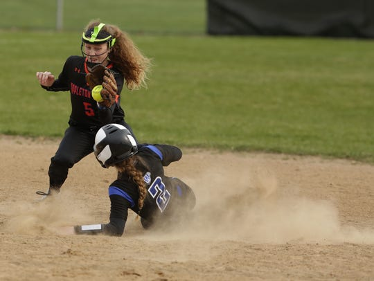 Oshkosh West's Neva Oates (2) slides safely into second