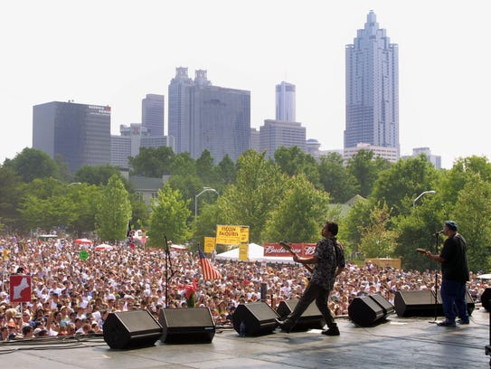 Mike Mesaros (left) and Pat DiNizio of the Smithereens at the at the Music Midtown Festival in Atlanta, Georgia in 2001.