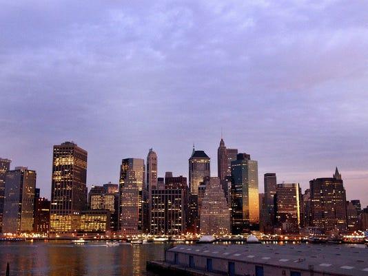 The Sun Rises Over The Manhattan Skyline