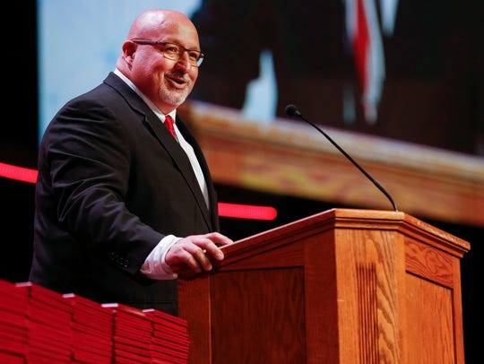 Superintendent Kevin Patterson speaks during Ozark High School's commencement ceremony at James River Church in May 2017.