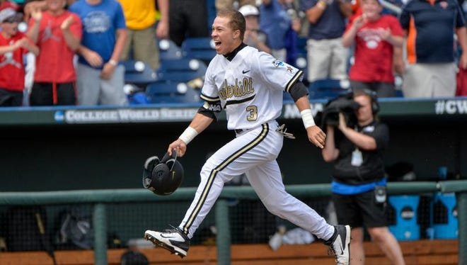 Vanderbilt's Jeren Kendall celebrates as he runs the bases after hitting the game-winning two-run home run in the ninth inning against Cal State Fullerton at the NCAA College World Series baseball tournament at TD Ameritrade Park in Omaha, Neb., Monday, June 15, 2015. Vanderbilt won 4-3.