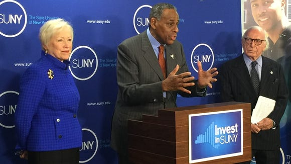 SUNY chairman Carl McCall speaks alongside Chancellor Nancy Zimpher in 2015 at an event near the state Capitol. SUNY is seeking more state aid and the authority to raise tuition.