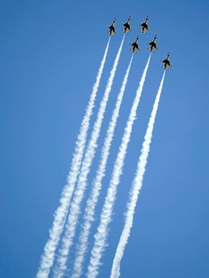 The Air Force Thunderbirds in flight.
