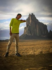"""This image from """"Mayors of Shiprock"""" shows Graham Biyáál, a founding member of the Northern Diné Youth Committee, near the Shiprock pinnacle."""