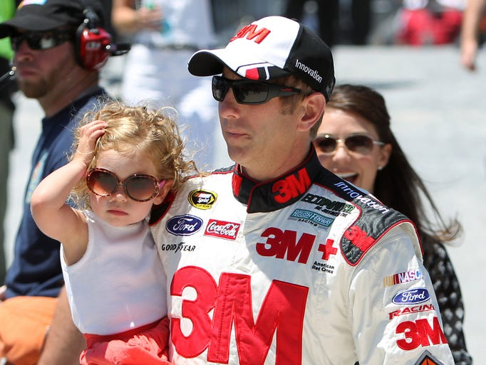 Greg Biffle carries his daughter Emma prior to the FedEx 400 at Dover International Speedway on June 1, 2014.