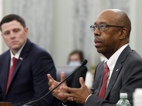 Michael V. Drake, right, testifies before a Senate Commerce Committee hearing in Washington.