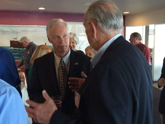 Sen. Ron Johnson listens as Door County Republican Party chairman Bill Berglund makes a point.