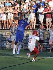 Xavier Johnson (1) of Summit pulls down a touchdown