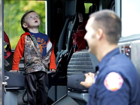 Finley Volkman, who is battling brain cancer, gets a look inside a fire truck as Tyler Hoertsch and members of the Fox Crossing Fire Department Station 40 and other new friends help celebrate his third birthday on Sunday, October 2, 2016 in Fox Crossing, Wisconsin.