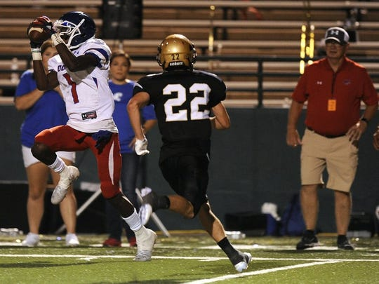 Thomas Metthe/Reporter-News Cooper wide receiver Myller Royals (1) pulls in a pass while being defended by Abilene High defensive back Doak Holloway (22) during the second quarter of the Cougars' 55-38 loss to Abilene High in the crosstown football game on Friday, Sept. 9, 2016, at Shotwell Stadium.