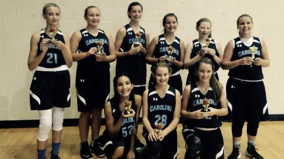 The Team Carolina 13U girls basketball team.