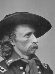A lock of hair thought to belong to George Armstrong Custer, a U.S. Army major general who was killed in battle at the Battle of the Little Bighorn, was sold at auction in Dallas for $12,500.
