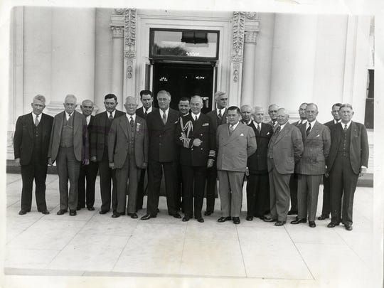 President Franklin Roosevelt hosts a governors' luncheon in this historic file photo. Vermont Gov. George Aiken is on the far left of the photo, on the end in a dark suit.