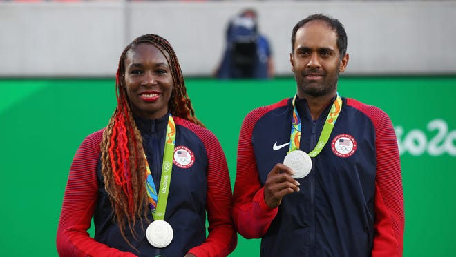Silver medalists Venus Williams and Rajeev Ram of the United States pose on the podium during the ceremony for the mixed doubles on Day 9 of the Rio 2016 Olympic Games at the Olympic Tennis Centre on August 14, 2016 in Rio de Janeiro, Brazil.