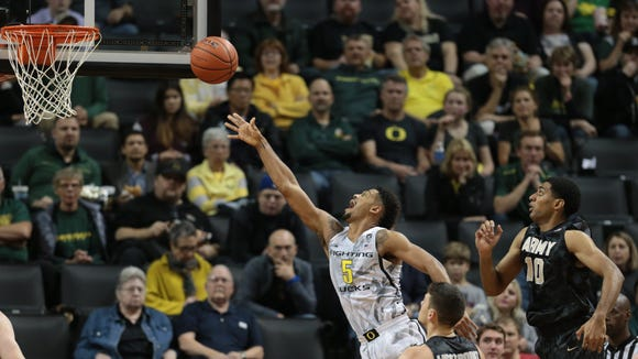 Nov 11, 2016; Eugene, OR, USA; Army Black Knights guard Thomas Funk (11) and Army Black Knights forward Kennedy Edwards (10) watch as Oregon Ducks guard Tyler Dorsey (5) shoots the ball in the second half at Matthew Knight Arena. Mandatory Credit: Scott Olmos-USA TODAY Sports