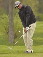 Canton's Suhas Potluri watches closely as he chips