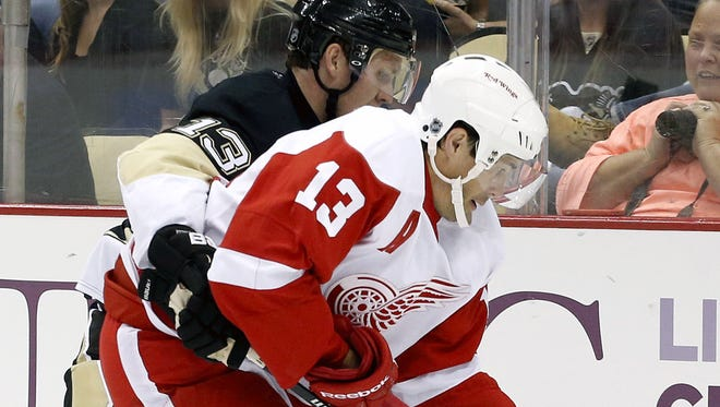 Detroit Red Wings center Pavel Datsyuk, right, had a goal and assist on Monday night before injuring his shoulder.