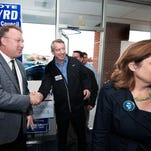 (11/3/14) - (Harrisonburg) ------ Republican  candidate for the U.S. Senate Ed Gillespie, center, and his wife Cathy are greeted by Rockingham County Circuit Court Clerk Chaz Evans-Haywood, left, as they arrive for a campaign stop at Republican headquarters, Monday, Nov.3, 2014 in Harrisonburg, Va.  Gillespie,  is running against incumbent Sen. Mark Warner, D-Va., and Libertarian candidate Robert Sarvis.  (AP Photo/The Daily News-Record, Michael Reilly)