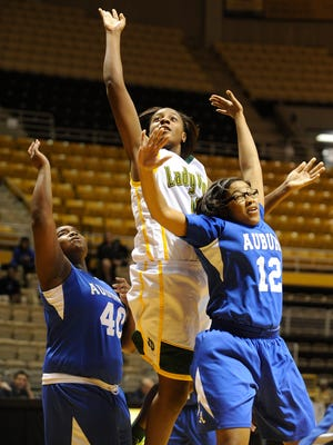 Jeff Davis' Kayla Jackson shoots over Auburn in AHSAA Central Regional action at the ASU Acadome at Alabama State University in Montgomery, Ala. on Wednesday February 11, 2015.