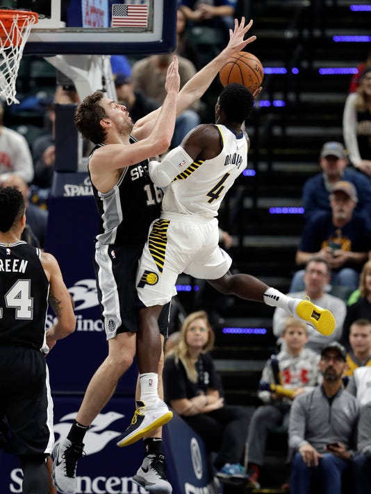 Indiana Pacers' Victor Oladipo (4) shoots against San Antonio Spurs' Pau Gasol (16) during the second half of an NBA basketball game, Sunday, Oct. 29, 2017, in Indianapolis. (AP Photo/Darron Cummings)