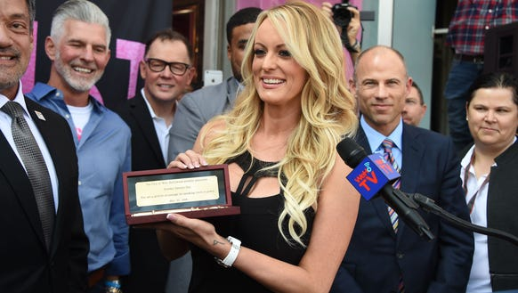 Adult film star Stormy Daniels receives a key to the