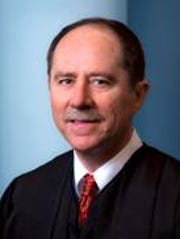 Justice Daryl Hecht