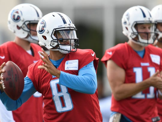 Titans quarterback Marcus Mariota (8) throws a pass
