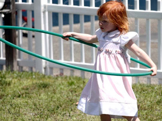 An Island Montessori Academy student plays with a hula hoop on Tuesday, May 17, 2017. Island Montessori Academy teachers use the Montessori Method, a holistic educational approach that focuses on the child's cognitive, social, emotional and physical development.
