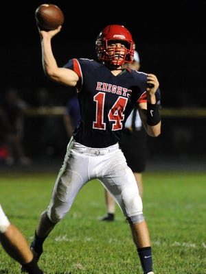 Fairfield Christian Academy senior quarterback Caleb Laubenthal throws a pass from a game earlier this season. He helped lead the Knights to a 43-21 win over Grove City Christian Saturday night.