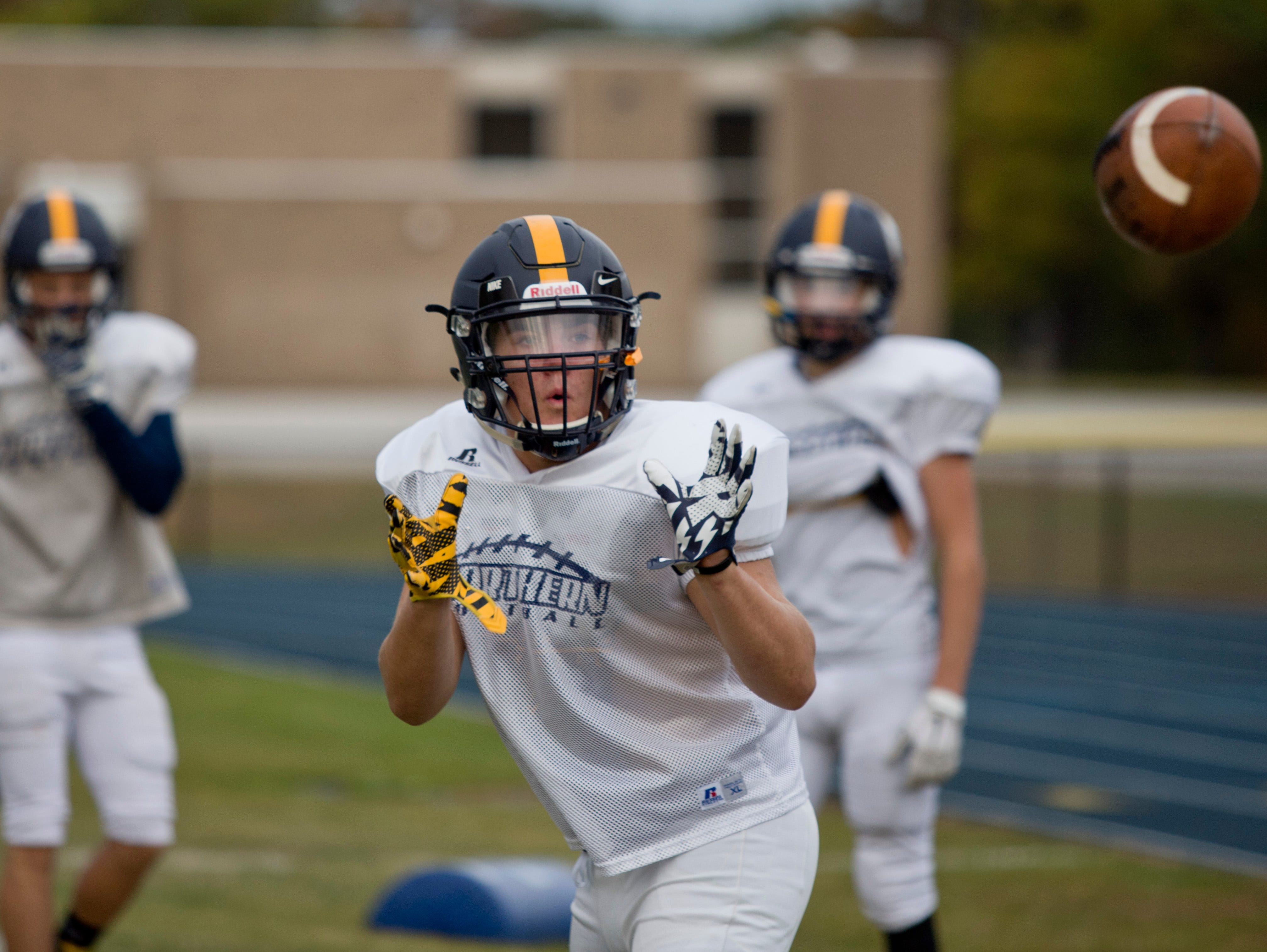 Senior Johnny Wurmlinger catches a pass during practice Wednesday, October 21, 2015 at Port Huron Northern High School.