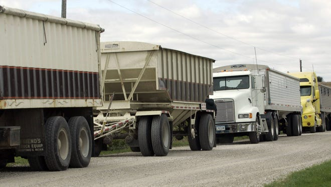 Grain truck line up ready to take the crop harvest near Grinnell in 2007.
