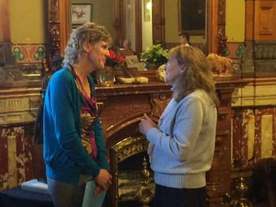 Former Iowa State runners Charlene (Letzring) Elyea, left, and Cathy (Hunter) Lynham talk during Wednesday's gathering.