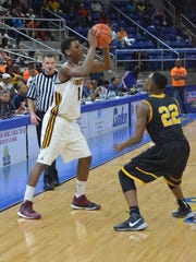 Natchitoches Central forward Brandon Rachal (1, left) is guarded by Scotlandville's Jordan Adebutu during the LHSAA Class 5A Finals in 2015.